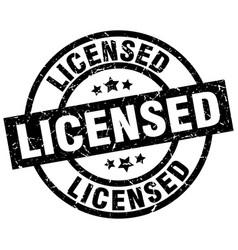 Licensed round grunge black stamp vector