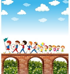 Children marching on the bridge vector image