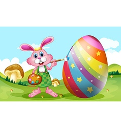 Happy easter with bunny painting egg vector