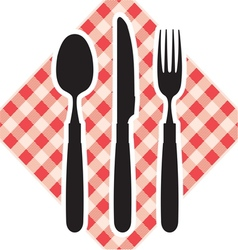 Cutlery on tablecloth vector image vector image