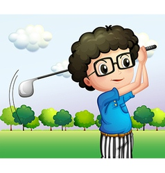 A boy with glasses playing golf vector image