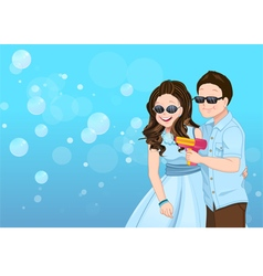 Playful couple cartoon with soap bubble guns vector