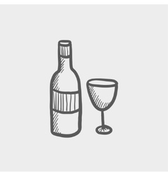 Bottle of whisky and a glass sketch icon vector