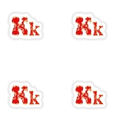 Assembly stickers fiery font red letter k on white vector