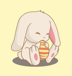 rabbit holding easter egg vector image vector image