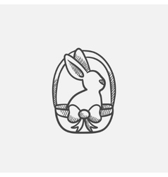 Easter bunny sitting in basket sketch icon vector