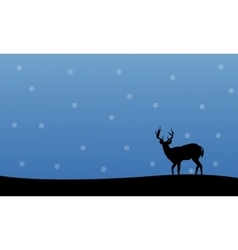 Silhouette of deer winter christmas scenery vector