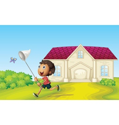 Boy catching butterflies vector image vector image