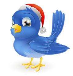 Blue bird in santa claus hat vector