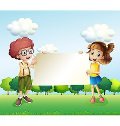 A boy and a girl holding an empty signage vector