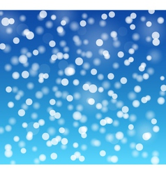 Snowflakes bokeh blue background vector image vector image