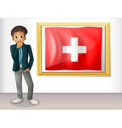 A man beside the framed flag of Switzerland vector image