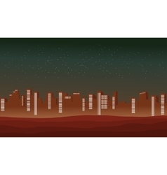 Silhouette of city at night for hills vector