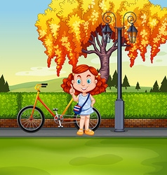 Little girl and bicycle in the park vector
