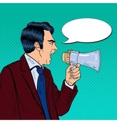 Angry businessman shouting in megaphone pop art vector