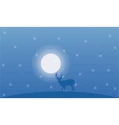 Deer at winter christmas landscape vector