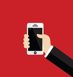 Hand holding white smartphone on red background vector