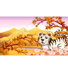 An autumn view with a tiger vector image vector image