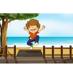 A boy jumping in the bridge vector image vector image