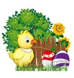 Fluffy chicken and painted easter eggs vector