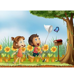 Children trying to catch a butterfly vector image vector image