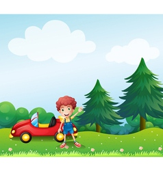 A young boy beside his car at the hill vector