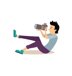 Sitting photographer in flat style vector