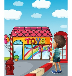 A boy standing near the toy store vector image vector image