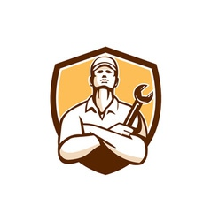 Mechanic arms crossed wrench shield retro vector
