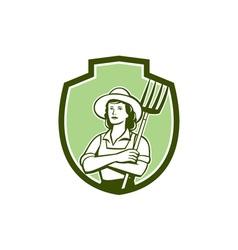 Female organic farmer pitchfork shield retro vector