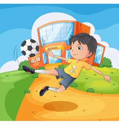A soccer player in front of the school building vector image vector image