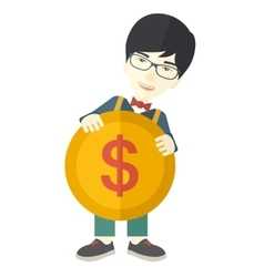 Asian businessman holding a big coin vector