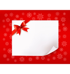 Christmas sheet of paper and red bows vector image