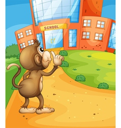 A monkey wondering in front of the school vector