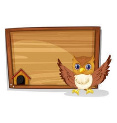 An owl in front of an empty board vector image vector image