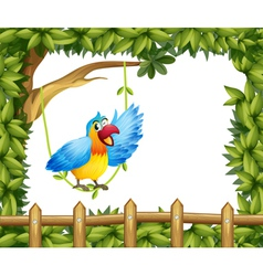 A parrot and the leafy green border vector
