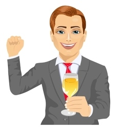 Businessman holding a glass of champagne vector