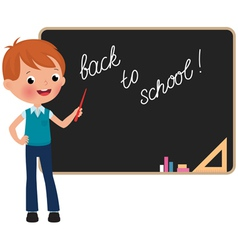 Schoolboy standing at the blackboard vector image vector image