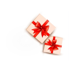 Holiday background with gift boxes with red bow vector