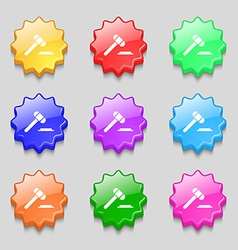 Judge hammer icon symbols on nine wavy colourful vector