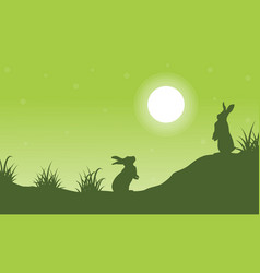 Silhouette of rabbit on hill scenery vector
