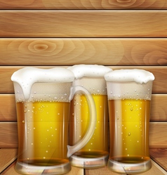 glasses of beer and a wooden background vector image