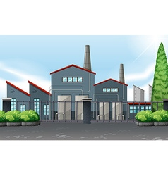 Factory building behind the metal fence vector