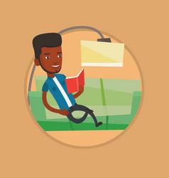 man reading book on sofa vector image