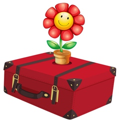 A red travelling bag with a plant vector