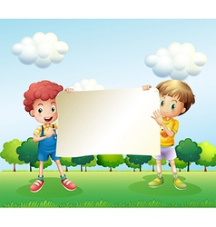 Two boys holding an empty signboard vector