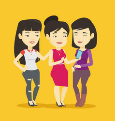 three smiling friends looking at mobile phone vector image