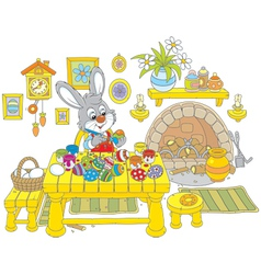 Bunny paints easter eggs vector