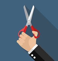 Hand holding a pair of scissors vector