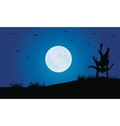 Silhouette of tree monster and full moon vector